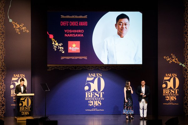 Chef Yoshihiro Narisawa on stage receiving the a�?Chefs Choice Awarda�� sponsored by Estrella Damm