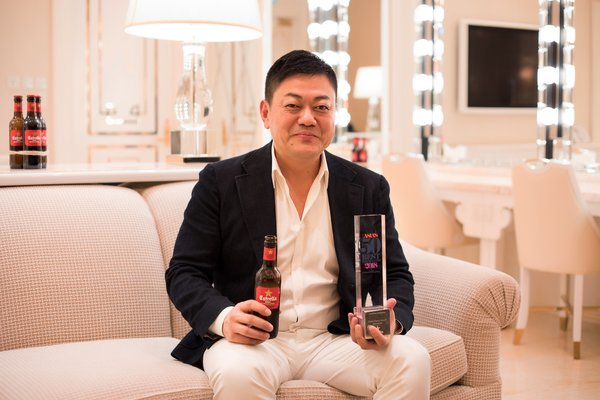 Chef Yoshihiro Narisawa being interviewed about his award win and enjoying a bottle of Estrella Damm