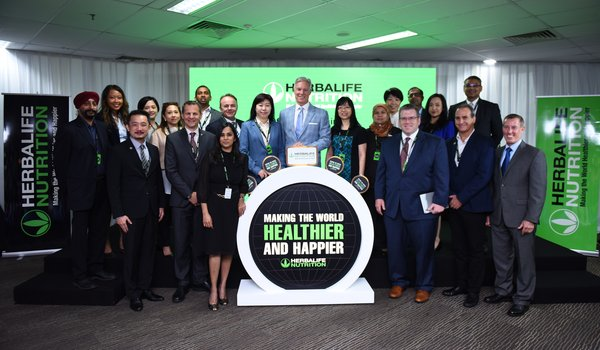 Herbalife CEO Rich Goudis (center) at the launch of the new Asia Pacific Shared Services Center, with Herbalife executives and guests, including Dato' Ng Wan Peng, COO of MDEC (to Goudis' left), Lim Bee Vian, Executive Director, Strategic Planning (Services), MIDA (to Goudis' right), Stephen Conchie, senior vice president and managing director, Herbalife Asia Pacific (fifth from left, second row), and Dean Thompson, Deputy Chief of Mission, US Embassy in Malaysia (third from right, front row).