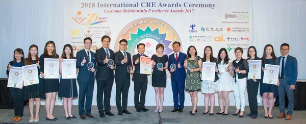 Hang Lung Properties' General Manager -- Human Resources Ms. Janet Poon (center) and the team receive eight awards at the 2018 International Customer Relationship Excellence Awards.