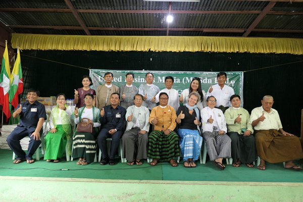 From left to right: Mrs. Maw Maw Khaing, Principal of Seikkyi Kanaungto School (2nd of 1st row); U Myo Thein from YCDC (4th of 1st row); U Aung Myint, President of MES (5th of 1st row); Ms. Eliane van Doorn, Business Development Director of UBM (7th of 1st row); U Khin Maung Htaey, Vice President of MES (8th of 1st row) and Ms. Vicky Tan, Senior Project Manager of UBM (6th of 2nd row) along with other partners during the MyanmarWater CSR Launch.