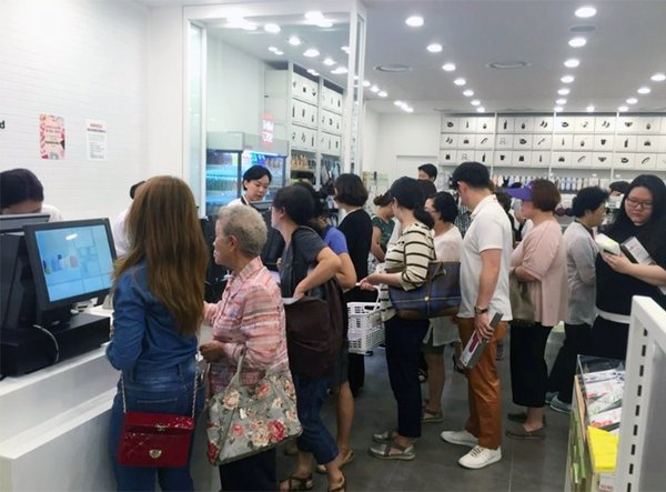 Consumers waiting in line for payment in MINISO