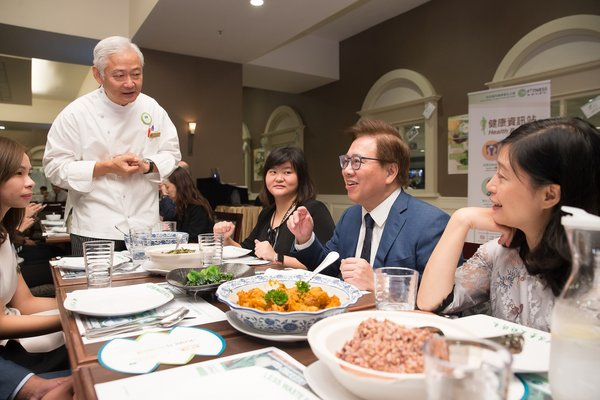 Sands China Ltd. President Dr. Wilfred Wong addresses team members dining at The Venetian Macao's back-of-house team member dining room during Green Mondays - part of the company's new myFITNESS initiative aimed at encouraging good habits for team members' health, physical fitness and well-being