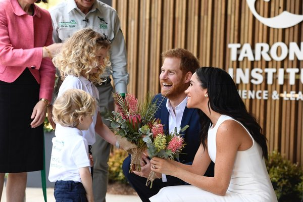Harry and Meghan - flower presentation at ribbon cutting