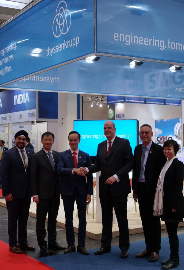 (2nd from L; L to R) Mr. Laurence Bay, Singapore Ambassador to Germany; Dr. Koh Poh Koon, Senior Minister of State for Trade and Industry; Dr. Donatus Kaufmann, Board Member of thyssenkrupp AG; Mr. Lim Kok Kiang, Assistant MD EDB; and the EDB team, at the announcement at Hannover Messe 2019