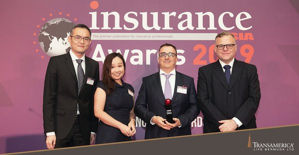 "Nicholas Kourteff (second from right), CEO of Transamerica Life Bermuda Singapore branch office, receiving the ""International Life Insurer of the Year - Hong Kong"" honour at the Insurance Asia Awards 2019."