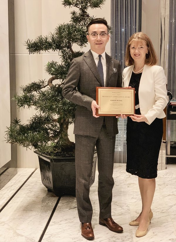 Simon Wang, Executive Assistant Manager, Niccolo Chengdu, is presented with the President's Appreciation Award by Dr Jennifer Cronin, President, Wharf Hotels, on Thursday 8 August 2019 in Chengdu.