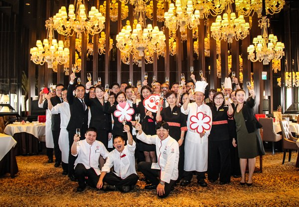 Executive Chef Chen Kentaro and his team at Mandarin Orchard Singapore celebrating their Michelin win