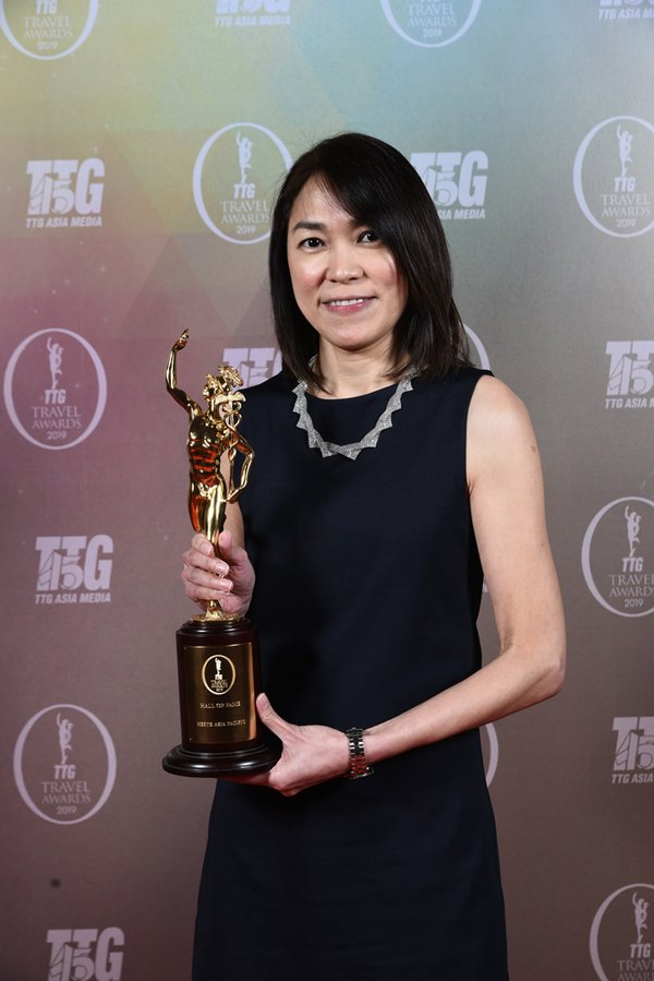 Brigette Tan, Senior Manager - Loyalty & Partnership Marketing, Hertz Asia Pacific, collects the Hall of Fame for Best Car Rental award at TTG Asia Travel Awards on behalf of Hertz.