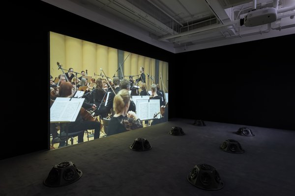 Muted Situations #22: Muted Tchaikovsky's 5th 2018 HD video, eight-channel sound installation, and carpet 45 min. Courtesy of the artist Installation view, 2019. Image: Winnie Yeung @ iMAGE28 Courtesy of M+, Hong Kong