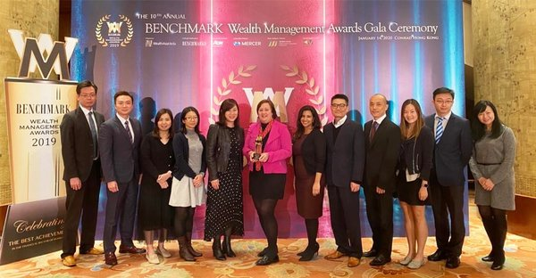 Hazel Etherington (centre), COO of Transamerica Life Bermuda, celebrates Outstanding Achiever award with her team at the 10th Benchmark Wealth Management Awards.