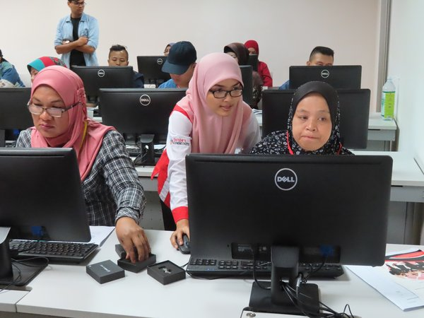 In one of last year's classes by PK Taylor's-CIMB Islamic, participants were taught to make presentation slides using computers. To adapt to today's climate, they have moved to learning online.