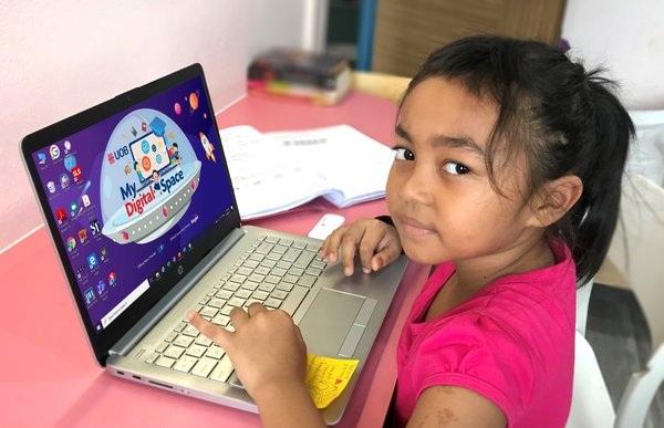 Nur Muliana Binte Mamat, a Primary 2 student from Fuhua Primary School who has received a UOB digital learning kit to aid in her home-based learning