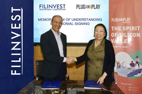 Josephine Gotianun-Yap, President and CEO of Filinvest Development Corporation, seals the partnership deal with Plug and Play's Shawn Dehpanah, Executive Vice President & Head of Corporate Innovation for APAC (Photo taken in February 2020).