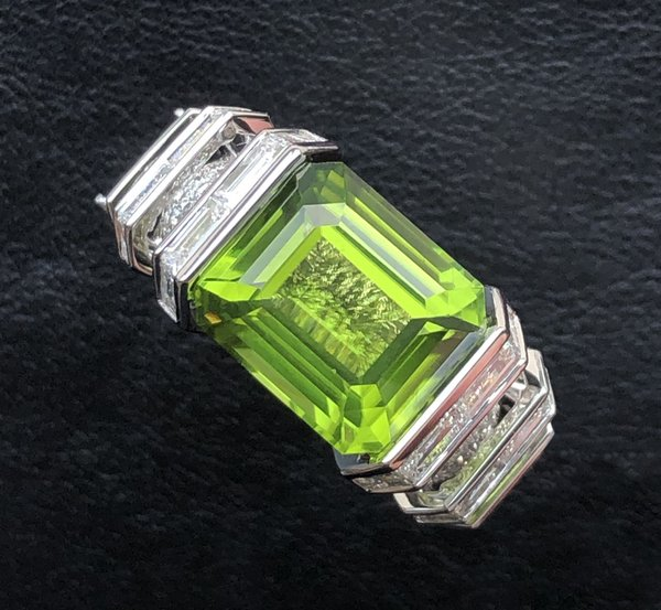 Customised white diamond enclave ring with rare 12.0 carats peridot gemstone