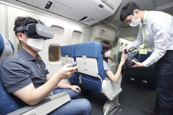 Passengers on a flight view immersive media contents via the KT Super VR service.