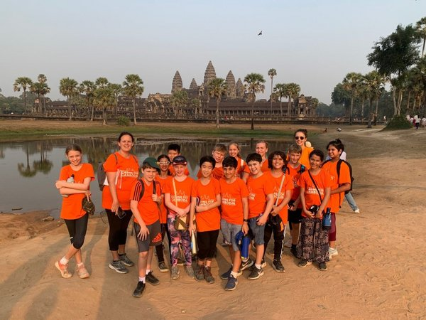 Children working alongside the local charity Caring for Cambodia.