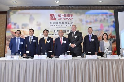 From left to right: Luis CHEIN, Director of WH Group; GUO Lijun, Executive Director, Executive Vice President and CFO of WH Group; YOU Mu, Executive Director, President of Shuanghui Development; WAN Long, Chairman and CEO of WH Group; Kenneth SULLIVAN, Executive Director, President and CEO of Smithfield Foods; Glenn NUNZIATA, CFO of Smithfield Foods; Joanna YAN, Finance Director of WH Group.