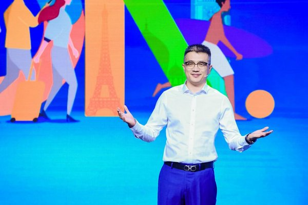 Trip.com Group CMO Bo Sun (pictured) announces the promotion at the company's