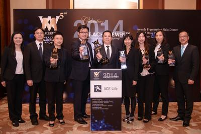 Mr. Allan Lam, Country President of ACE Life in Hong Kong (middle) led the senior management team to receive the 'Company of the Year -- Insurance' Award.