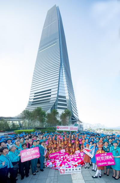 Over 200 Hong Kong Girl Guides take part in the 'Sewing Seeds of Love' event at the tallest building in Hong Kong -- International Commerce Centre (ICC).