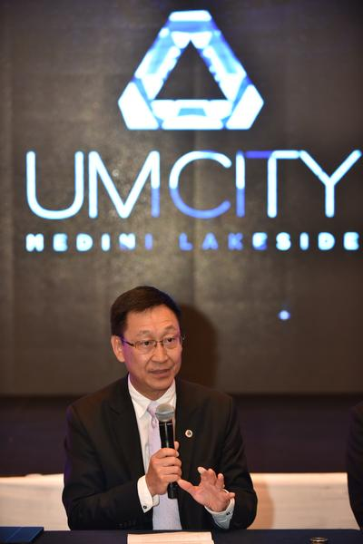 Datuk Chia Lui Meng, UMLand Group CEO interacting with the media