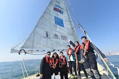 Famous Chinese Skipper of Guo Chuan Racing, with young people on the UNICEF supported yacht at Qindao port.