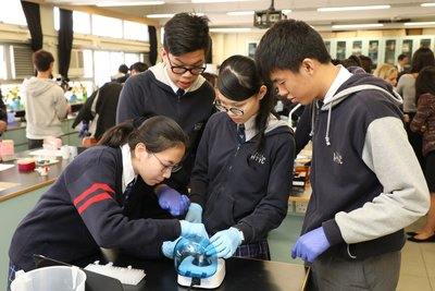 Form 6 students from Y.W.C.A. Hioe Tjo Yoeng College use a centrifuge as part of the Amgen Biotech Experience.