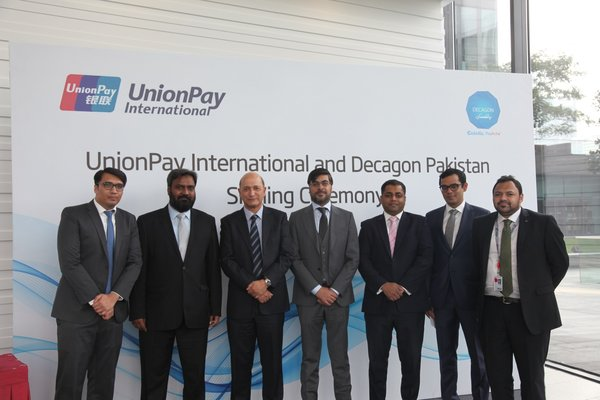 Mr. Shuan Ghaidan (3rd left), Director of Products of UnionPay International and Mr. Aziz Kassamali (4th left), Chairman Decagon signed the agreement.