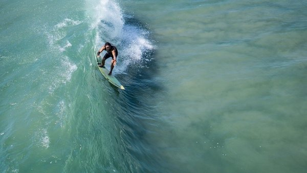 Ride the waves to your heart's content with Surf School Bali