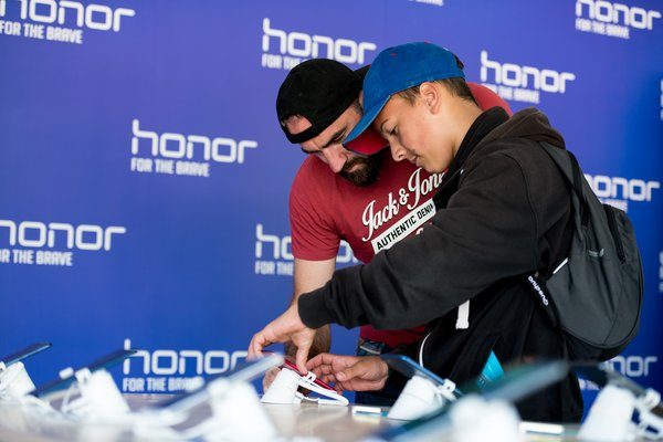 Fans testing out the new flagship product Honor 10, which will be launched in London on May 15, 2018