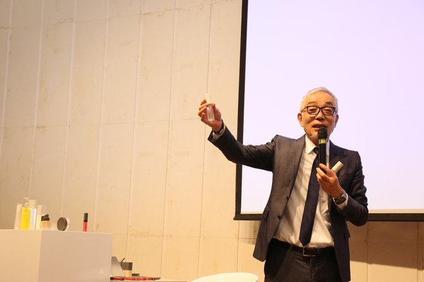 THREE Founder Yasushi Ishibashi introduces new products at the launch event in the NetEase Building, Hangzhou.