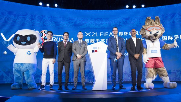 Vivo mascot and Zabivaka (FIFA World Cup mascot) join VIPs in commemorating Vivo smartphone entering the Home of FIFA