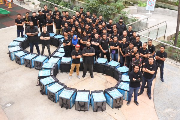 Co-founders (from left to right ) Jeevan Kumar, Sean Lee, Mohd Hafiz, & Devan Kumar ( standing at the circle) and their fleet of Zoomers