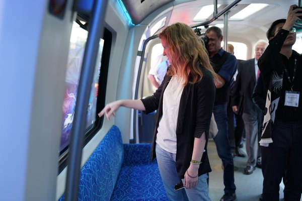 Media and visitors show great interests in CETROVO's magic window, which can transform into a touch-screen and allows passengers to perform tasks like watching videos and even paying tickets on it.