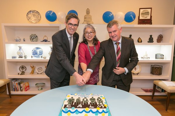 Cutting the cake (Tim Mackey, Canadian High Commission; Hanaa Wong, CALM President; Dr Chris Hartley, ELD)