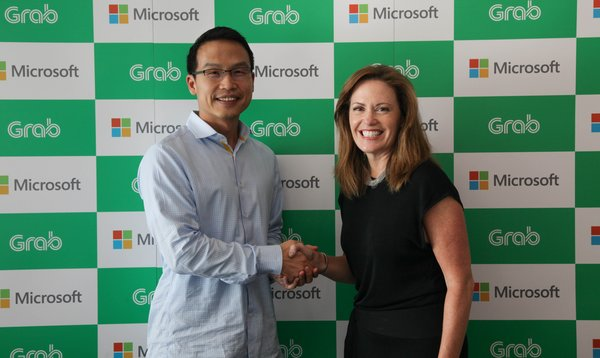 Ming Maa, president of Grab together with Peggy Johnson, executive vice president of Microsoft.