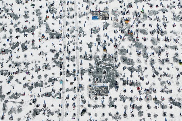 This undated file photo shows visitors ice fishing for pond smelt during the Inje Icefish Festival in Inje, a mountainous town 165 kilometers east of Seoul.