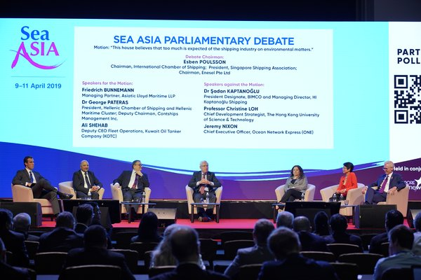 Industry thought leaders discussing the important topic of 'This house believes that too much is expected of the shipping industry on environmental matters' at the Sea Asia Parliamentary Debate