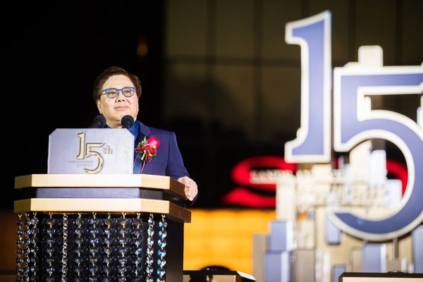 Sands China Ltd. President Dr. Wilfred Wong speaks at Sands Macao's 15th anniversary celebration Thursday at the hotel and entertainment complex's outdoor fountain.