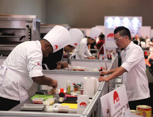 Michelin-starred Chef Kwok-keung Chan observes the Salon Culinaire Chef Competition (lamb category) sponsored by Lee Kum Kee at Food & Hotel Indonesia (FHI) 2019 on Thursday (25/7). Winners of the competition will represent Indonesia to participate in the Lee Kum Kee International Young Chef Chinese Culinary Challenge staged in Hong Kong next year.