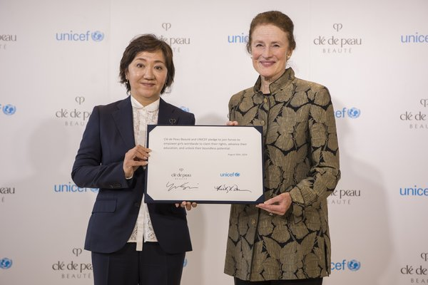 Ms. Yukari Suzuki, Chief Brand Officer of Clé de Peau Beauté (L) and Henrietta Fore, Executive Director, UNICEF (R) showcasing a joint pledge to empower girls to unlock opportunity and potential through education