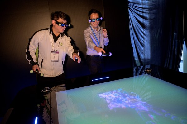 "The booth of Construction Industry Council showcases advanced construction technologies. The ""Hologram Table"" provides interaction with users by displaying 3D images of buildings and objects"