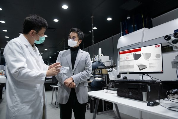 Caption I: New World Development CEO Adrian Cheng (right) listened to Dr. Tom Kong, CEO of Master Dynamic about the characteristics of NanoDiamonds technology. The company's goal is to transfer the antibacterial coating technology applied to jewellery to the non-woven material of surgical masks, thereby blocking and inhibiting bacteria and viruses.
