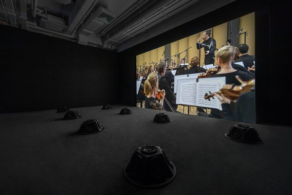 Muted Situations #22: Muted Tchaikovsky's 5th, 2018. HD video, eight-channel sound installation, and carpet, 45 min, Courtesy of the artist. Installation view, 2019. Image: Winnie Yeung @ iMAGE28, Courtesy of M+, Hong Kong
