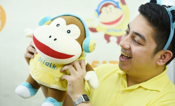 A Filipino online English teacher from 51Talk interacts with a Chinese student using the platform's mascot named Max.